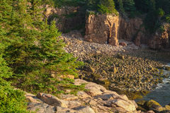 Secluded cove filled with pink granite cliffs and rocky boulders Royalty Free Stock Images