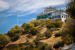 Secluded House. An isolated house a top a small hill Stock Photos