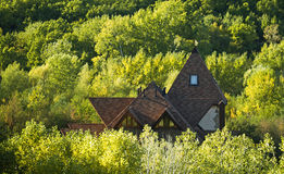 Secluded house in a forest green fall. And rock Stock Photo