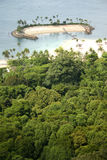 Secluded island in the tropics stock photography