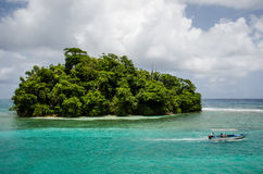 Secluded island vacation oasis stock images