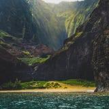 Secluded Kalalau Beach. Stunning view of secluded Kalalau Beach and Kalalau Valley from a boat on a sunny day, Na Pali Coast, Kauai, Hawaii Royalty Free Stock Photography