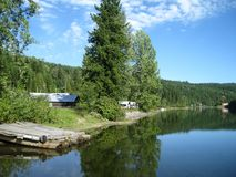 Secluded lake cabins Stock Images