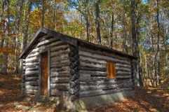 Secluded log cabin Stock Images