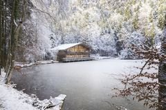 Secluded mountain lake freezes over in the winter and creates magical moments royalty free stock photo