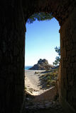 Secluded nudist beach. Torn Beach (Spain), viewed from accessing tunnel; man walking far away Royalty Free Stock Photos