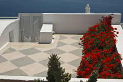 A Secluded Patio. High over the sea and the blue water of the Caldera, Ia, Santorini Royalty Free Stock Images