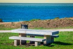 Secluded place for meditations on the sea shore. On a bench Royalty Free Stock Images