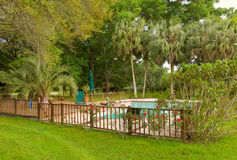 A secluded pool deck in florida Royalty Free Stock Image