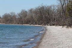 Secluded Rocky Beach - Early Spring. This is a secluded rocky beach in early spring Stock Photo