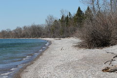Secluded Rocky Beach -- Early Spring. This is a secluded rocky beach in early spring Stock Image