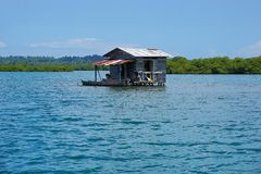 Secluded rustic hut on stilts over the water Stock Image