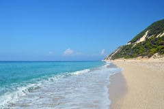 Secluded sandy beach in quiet sunny day with calm turquoise sea Stock Photography