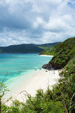 Secluded tropical paradise beach with clear blue lagoon water, Amami Oshima Island, Japan Stock Photography
