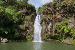 Secluded tropical waterfall Stock Image