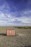 Secluded vacation getaway striped beach hut Royalty Free Stock Photos