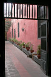 Secluded Walkway. Wallkway with potted plants in Peru Stock Photography