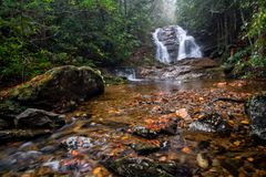 Secluded Waterfall. Lower Bubbling Spring Branch Falls in North Carolina. A very beautiful 20 foot waterfall near the Blue Ridge Parkway. Seen here in fall on a royalty free stock photo