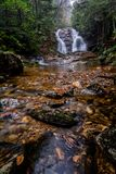 Secluded Waterfall. Lower Bubbling Spring Branch Falls in North Carolina. A very beautiful 20 foot waterfall near the Blue Ridge Parkway. Seen here in fall on a stock images