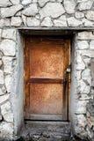 Secluded Wooden Door Set in Brick Stock Photo