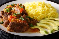Free Seco De Chivois Goat Stew With Yellow Rice And Avocado Close-up On A Plate. Horizontal Stock Photos - 114862603