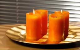 Second advent. Two advent candles on a golden plate Royalty Free Stock Image