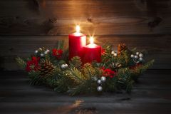 Second Advent - Decorated Advent wreath with a red burning candle on a wooden background with festive atmosphere Royalty Free Stock Photos