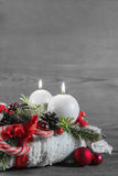 Second advent: two red burning candles on wooden shabby backgrou Royalty Free Stock Image
