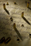 Second amendment with bullets casting shadows onto the document. Second amendment with bullets casting shadows Royalty Free Stock Image