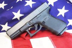 Second Ammendment. 9mm pistol on us flag Stock Photo