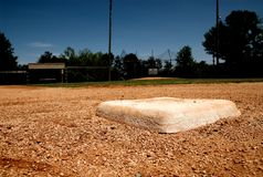 Second base bag on baseball field. A baseball base on a little league field in focus royalty free stock photos