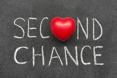Second chance. Phrase handwritten on blackboard with heart symbol instead of O Stock Photography