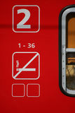 Second class. Detail of a red second class train car for nonsmokers Royalty Free Stock Photo