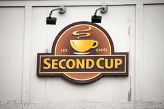 Second Cup Coffee logo in front of their local cafe in downtown Montreal, Quebec. Second Cup is Canadian cafe & coffee brand royalty free stock image