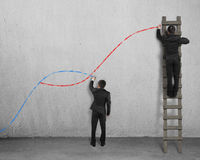 The second curve concepts. Two man holding chalk drawing curves on concrete wall Royalty Free Stock Photography