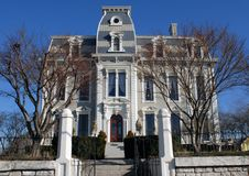 Second Empire Style House. Historic Second Empire style house, called the Bossler Mansion, was built in 1869 of cut Delphos stone, soft brick and limestone. It Royalty Free Stock Image