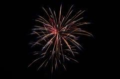 Fireworks. 3 second exposure firework image on a dark sky.  Minimalist and simplistic Stock Photos