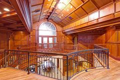 Second floor landing accented with wood paneled walls and ceiling. Amazing wedding venue interior, Seattle, WA stock photos