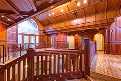 Second floor landing accented with wood paneled walls and ceiling. Amazing wedding venue interior, Seattle, WA royalty free stock photo