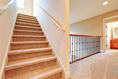 Second floor landing with a staircase. stock photos