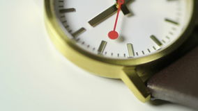 Second hand on beautiful watch. Second hand extreme detail of a beautiful clock on a white background - tilt-shift lens used stock video