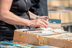 Second Hand Book Stall. Woman Buying Books Stock Photos