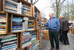 Second Hand Books. People browsing books at second hand bookmarket. Picture taken on April 13, 2009 in The Hague, Holland Royalty Free Stock Photos