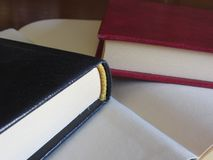 Second hand books with blank pages on a wooden table Royalty Free Stock Image