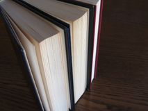Second hand books standing on a wooden table . View from above . Top view Royalty Free Stock Photos