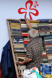 Second-hand Bookseller. TBILISI, GEORGIA � JUNE 13, 2015: Second-hand bookseller arranges second-hand books in the street of the city stock photo