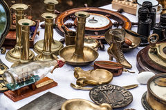 Second hand brass candle holders at antique dealer show Royalty Free Stock Photography
