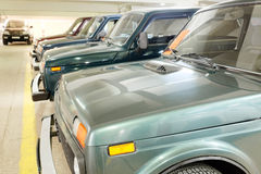 Second-hand cars in dealer's showroom. Stock Images