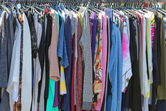 Second Hand Clothes. Rails at Flea Market Stock Image