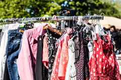 Second hand pink fashion women's clothing at flea market Stock Photos